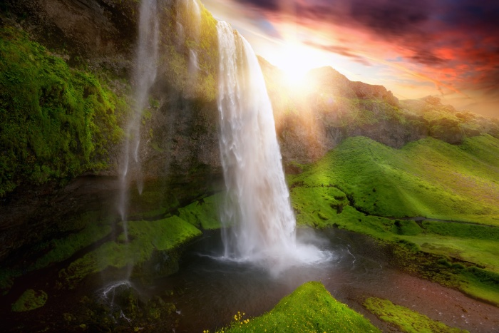Beautiful and dramatic sunset in Seljalandsfoss waterfalls, Iceland